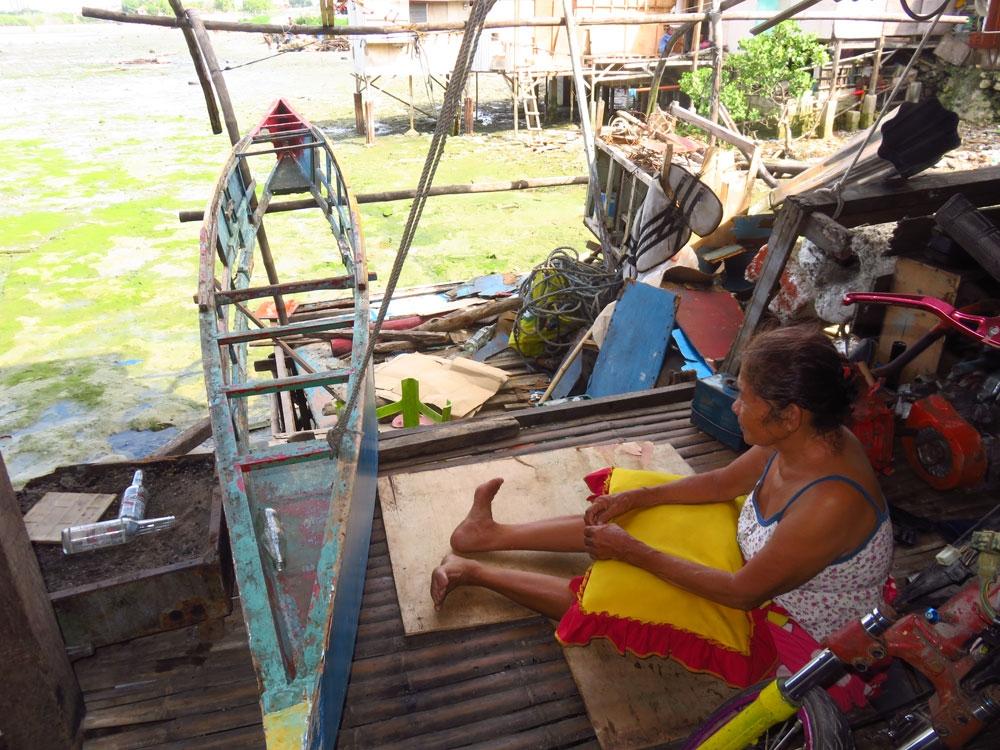 Familiar shore. Estrella Roble, 69, watches from a distance as a demolition team goes to work in coastal Barangay Ibo, Lapu-Lapu City.  (SunStar Foto/Allan Cuizon)