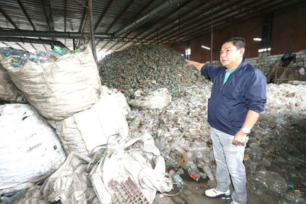 PAMPANGA. Sto.Tomas Mayor John Sambo points to a pile of plastic at the MMK recycling plant in Barangay San Matias which was closed by the local government, BFP and PNP on Thursday for alleged violations and operating without a business permit. (Chris Navarro)