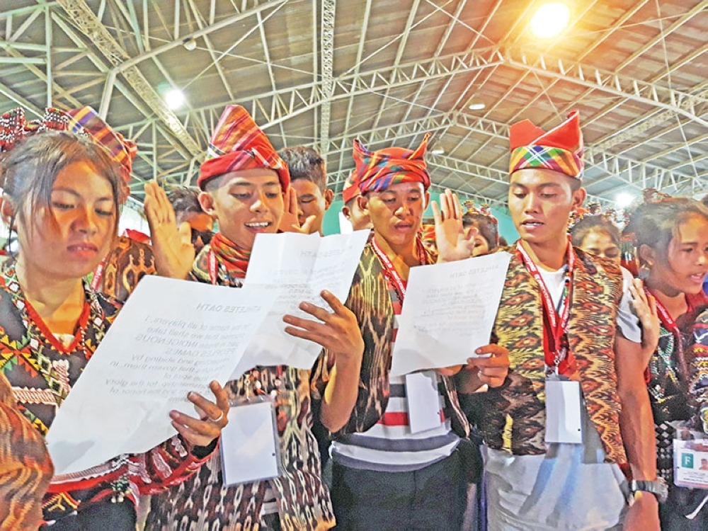 DAVAO. Participants of the 2nd Indigenous Peoples Games take their oath of sportsmanship during the opening ceremonies held at the Lake Sebu Municipal Gym yesterday afternoon. (Photo by Marianne L. Saberon-Abalayan)
