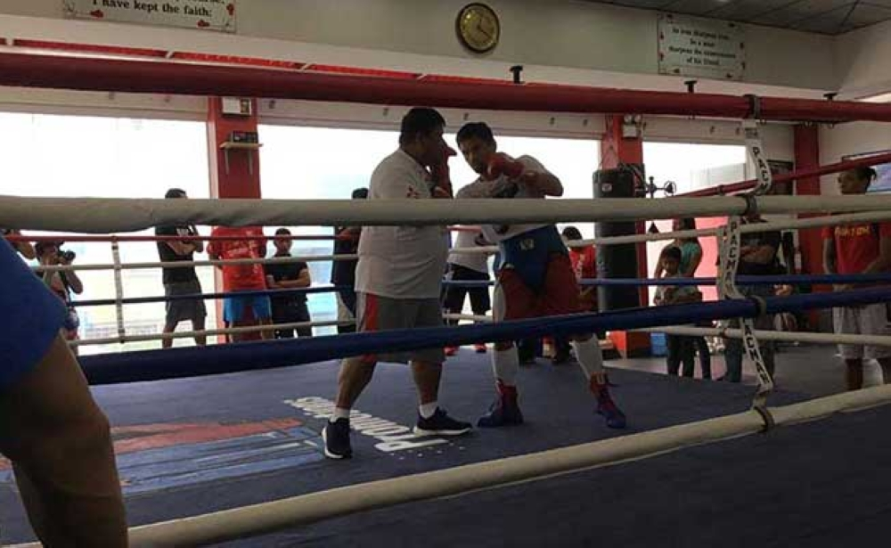 GENERAL SANTOS CITY. Manny Pacquiao trains with coach Buboy Fernandez at the Pacman Wildcard Gym in General Santos City Friday afternoon. (Marianne L. Saberon-Abalayan)