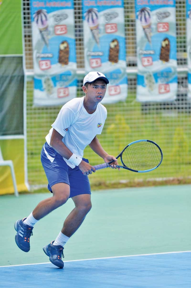 PANABO CITY. John Bryan Otico of Bukidnon and Johnny Arcilla of Butuan City clash for the men's single title of the 2nd Mayor James Gamao Cup National Invitational Tennis Championship at the Panabo City twin courts as of Saturday. (Boy Diong)