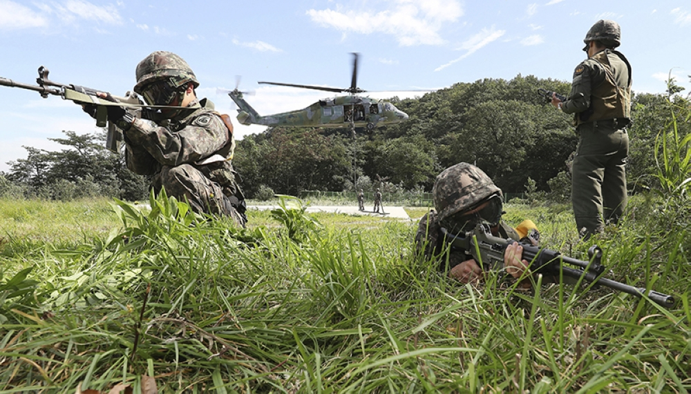 SOUTH KOREA. In this Aug. 29, 2017 file photo, South Korean army soldiers aim their machine guns during the annual Ulchi Freedom Guardian exercise in Yongin, South Korea. (AP)