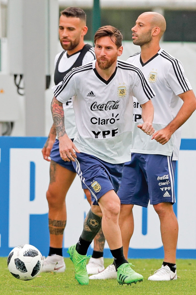 RUSSIA. Lionel Messi plays the ball during a training session of Argentina at the 2018 soccer World Cup in Bronnitsy, Russia, Tuesday, June 19, 2018. Argentina plays Croatia on Friday. (AP)