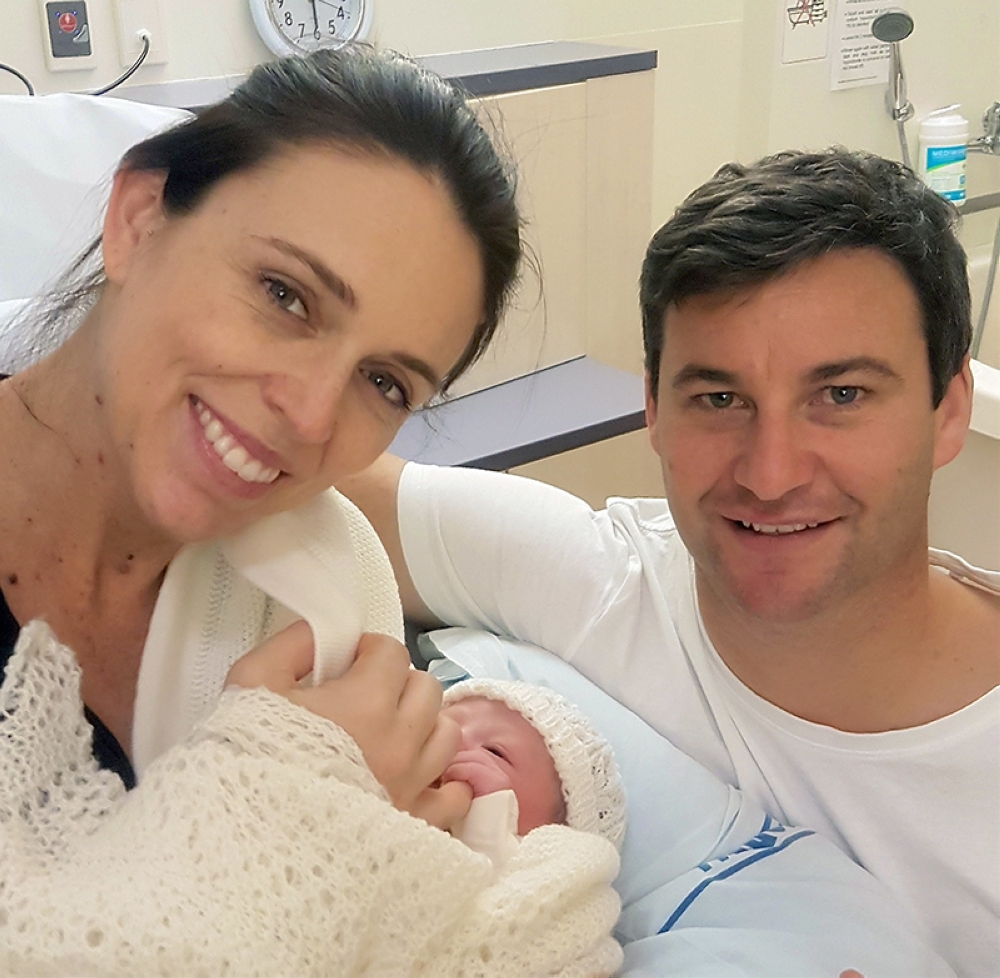NEW ZEALAND. In this photo released by the Office of the Prime Minister of New Zealand, Prime Minister Jacinda Ardern and her partner Clarke Gayford pose with their newborn daughter at the Auckland City Hospital, Thursday, June 21, 2018, in Auckland, New Zealand. (Office of the Prime Minister of New Zealand via AP)