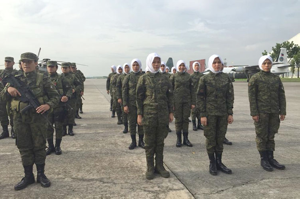 """MANILA. The 130 personnel of the 12th Civil-Military Operations """"Kabukludan"""" Battalion and Hijab Troopers prepare themselves during their  send-off ceremony on June 21, 2018, at Colonel Jesus Villamor Air Base, Pasay City. (Photo courtesy of Major Arturo Dumalagan)"""