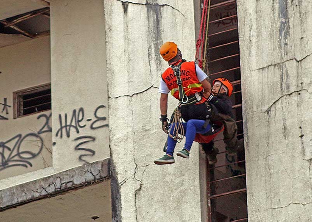 BAGUIO. Members of La Trindad Municipal Disaster Risk Reduction and Management Council demonstrate a simulation exercise on high angle rescue  during the 2nd quarter nationwide simultaneous earthquake drill in Wanagal, La Trinidad on Thursday, June 21. (Photo by Milo Brioso)