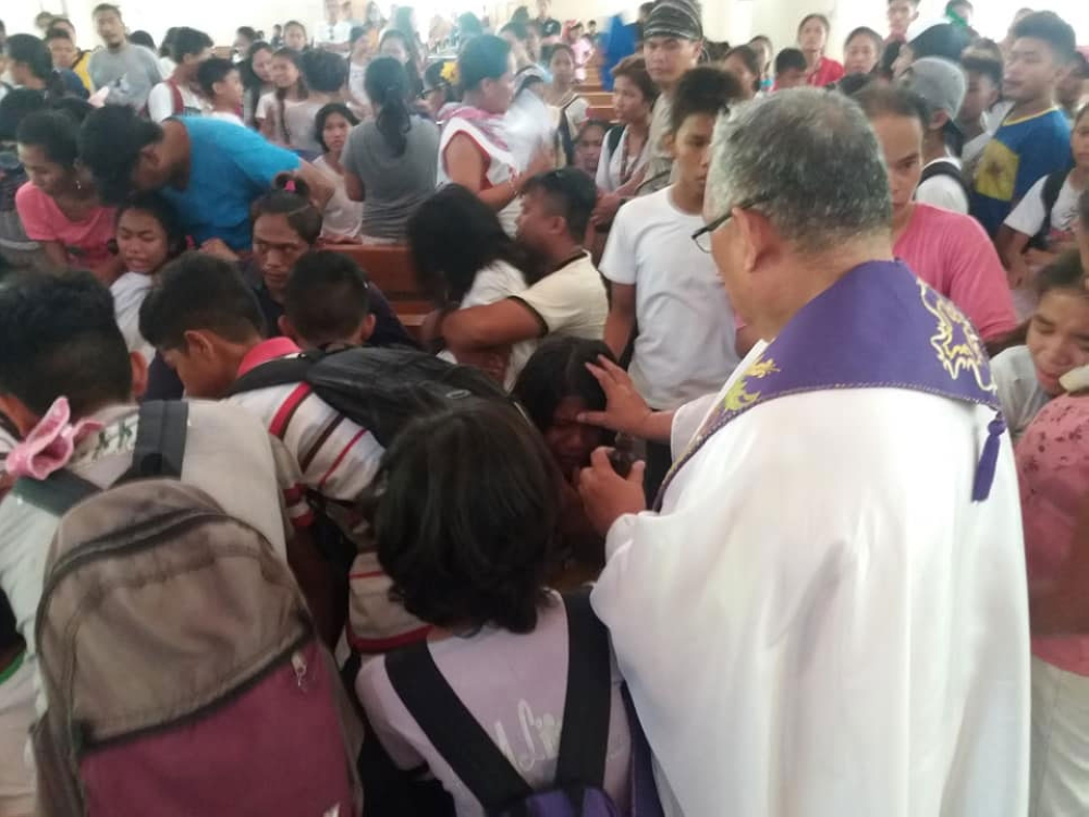 Demonic possession? Some students were brought to the church where a priest prayed for them. (Contributed Photo)