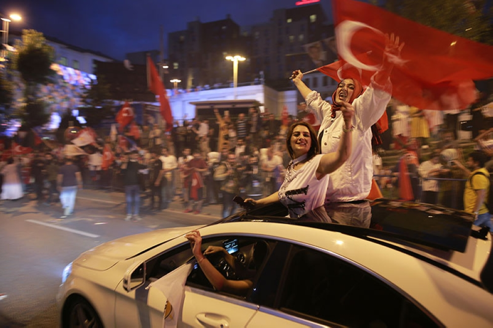 TURKEY. Supporters of Turkey's President and ruling Justice and Development Party, or AKP, leader Recep Tayyip Erdogan celebrate outside the party headquarters in Istanbul, Sunday, June 24, 2018. (AP)