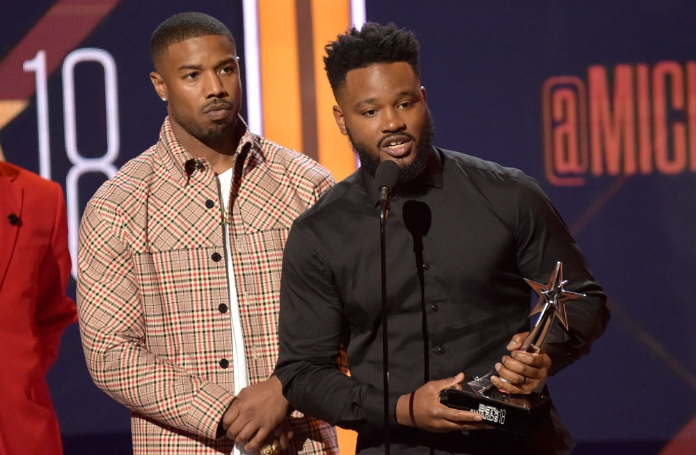 """'Black Panther.' Michael B. Jordan (left) accompanies director Ryan Coogler in accepting the best movie award for """"Black Panther."""" Last week, the film also made a haul at the MTV Movie and TV Awards. (AP Fotos/Richard Shotwell)"""