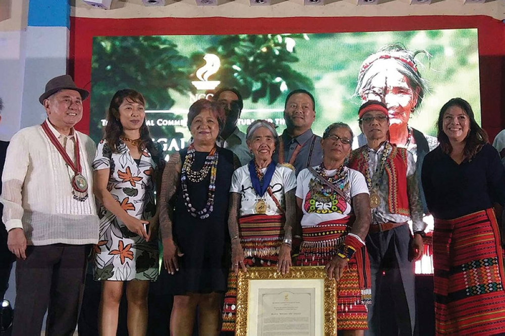 Honoring an icon. Whang-od Oggay receives the highest award the NCCA conferred by Virgilio Almario, national artist for literature and chairman of the commission. (Maria Elena Catajan)