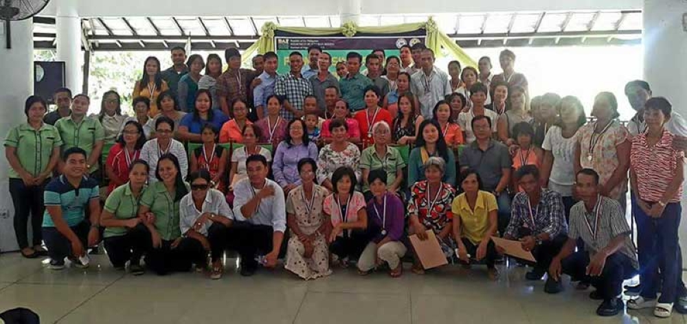 BACOLOD. Agrarian reform beneficiary-graduates of Farm Business School Program in the southern portion of the province with DAR personnel headed by Provincial Agrarian Reform Program Officer II Lucrecia Taberna (seated fifth from left, second row) in rites held at May's Organic Garden in Bacolod City yesterday, June 26. (Contributed Photo/DAR-Negros Occidental)