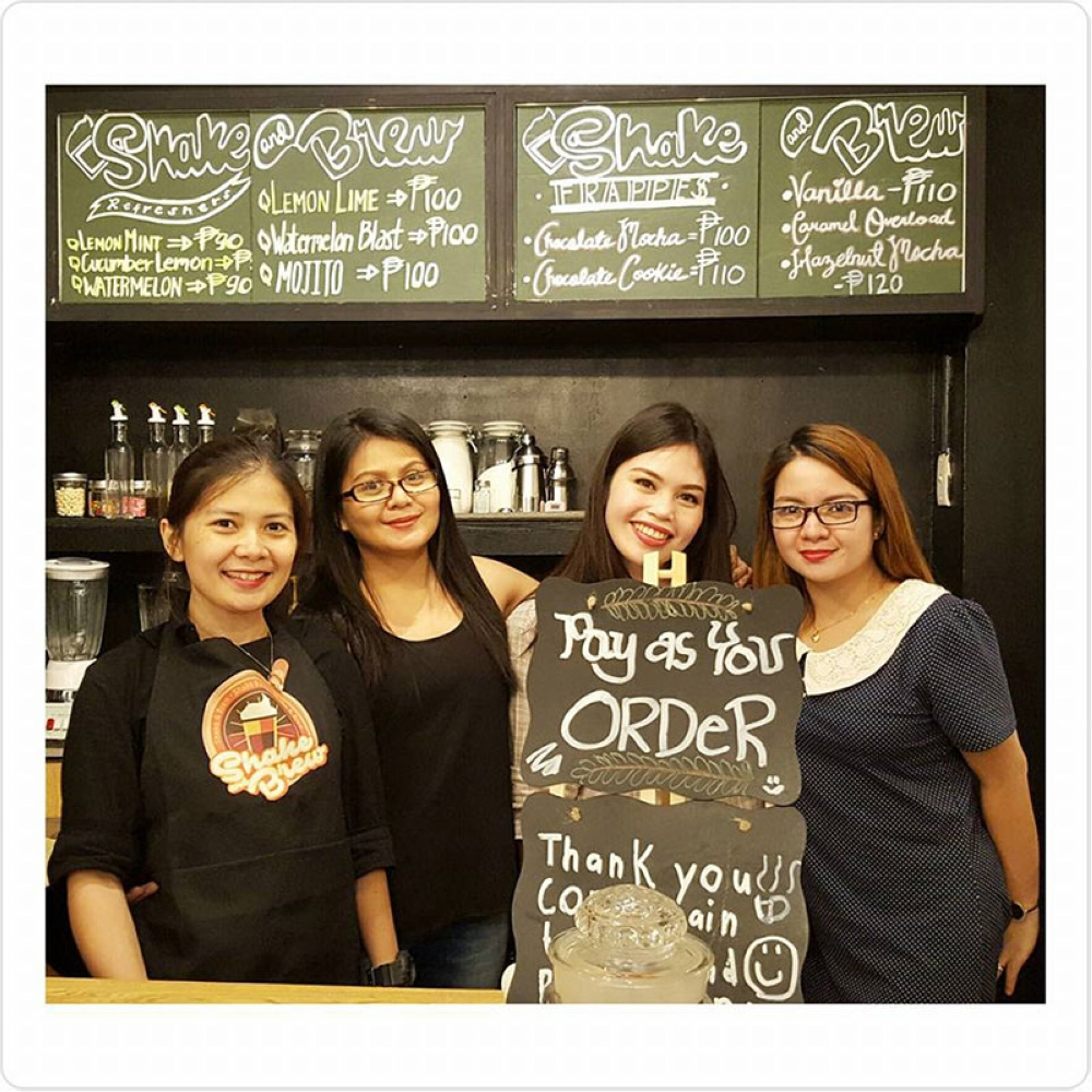 CAGAYAN DE ORO. Businesswoman Shiela Andrea Cang (left-most) with friends inside her cafe.