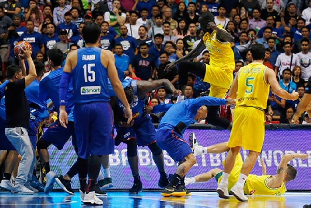 MANILA. The Philippines players, left and Australian basketball players react, during the FIBA World Cup Qualifiers Monday, July 2, 2018 at the Philippine Arena in suburban Bocaue township, Bulacan province north of Manila, Philippines. Australia defeated the Philippines 89-53 via default following a brawl in the third quarter.  (AP)