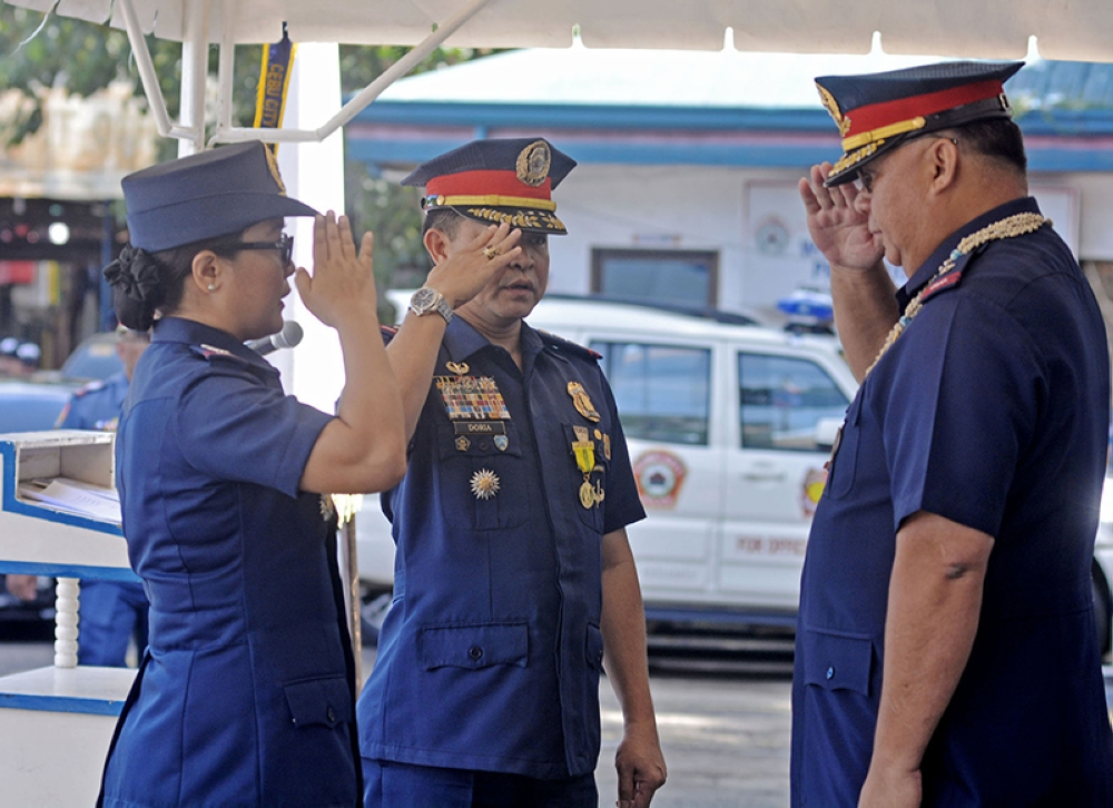 CEBU. Outgoing CCPO Director P/Sr. Supt Joel Bargamento Doria (center) and newly-installed CCPO Director P/Sr. Supt. Royima Garma (left) salute to the PRO 7 Regional Director P/Chief Supt. Debold Sinas (right) during a turnover ceremony Monday morning, July 2, at the CCPO ground in Gorordo street, Cebu City.  ( Amper Campaña)