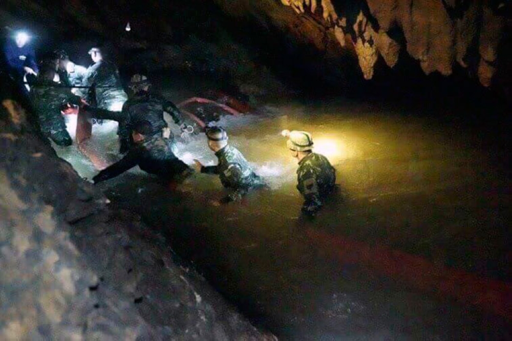 THAILAND. In this handout photo released by Tham Luang Rescue Operation Center, Thai rescue teams walk inside cave complex where 12 boys and their soccer coach went missing, in Mae Sai, Chiang Rai province, in northern Thailand, Monday, July 2, 2018. (AP)