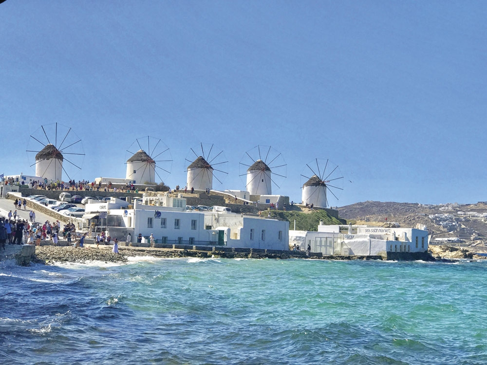 Windmills of Mykonos. Year-round winds are a perfect spot for these structures once used to refine grain.