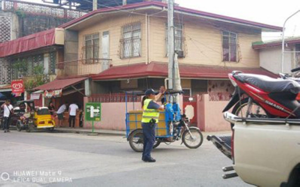 PANGASINAN. Senior Police Officer 4 Racquel Mamaradlo of the Malasiqui Police shows off her terpsichorean skills while directing traffic at an intersection. (Photo courtesy of Malasiqui Police Station)