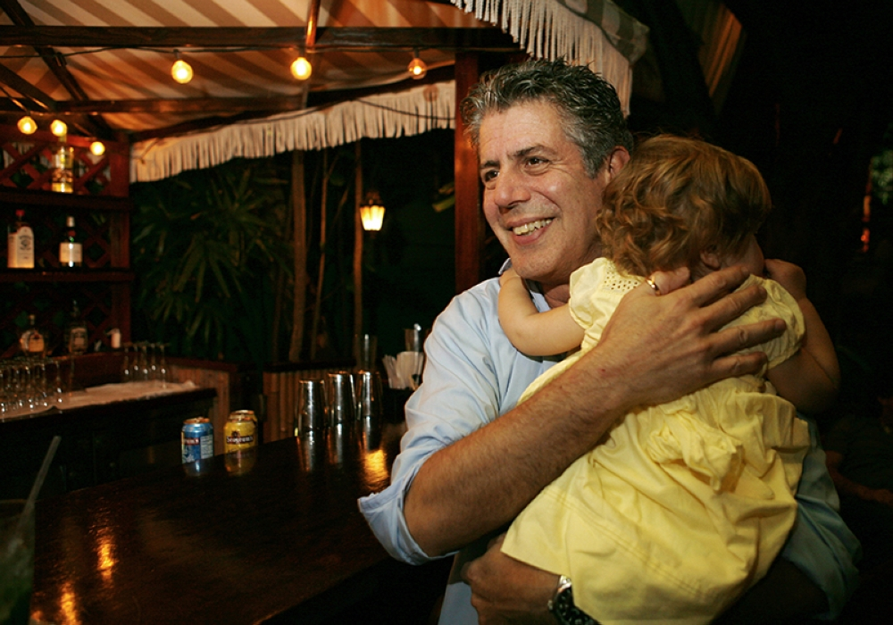 CALIFORNIA. In this Nov. 12, 2008 file photo, Chef Anthony Bourdain holds his daughter Ariane in Miami Beach. Court papers show that Bourdain was worth $1.2 million when he died last month. Most of the estate has been left to his daughter, who is now 11-years-old. Bourdain was found dead June 8 in an apparent suicide in his French hotel room while working on his CNN series
