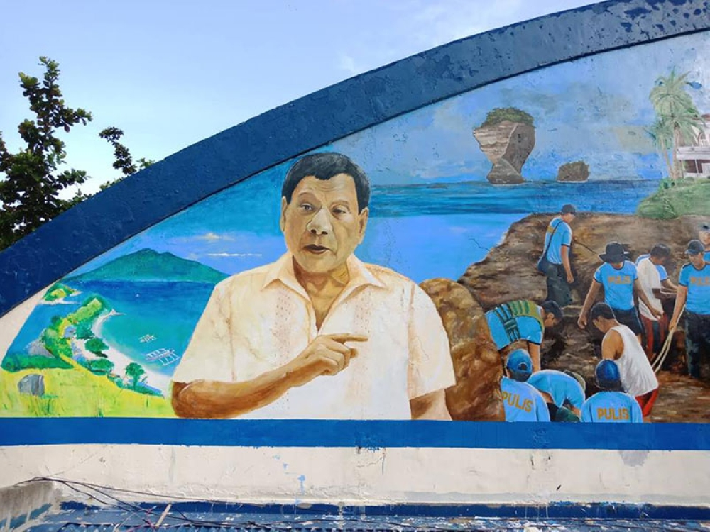 LEYTE. Tacloban artists Dante Enage, Philip Salem, Archie Prisno and Clint Gonzales completed the mural at the Philippine National Police headquarters in Palo, Leyte on July 4. The mural, measuring 20x60ft, shows policemen during disaster rescue, gift giving, and medical mission, among other police activities. (Photo courtesy of Dante Enage)