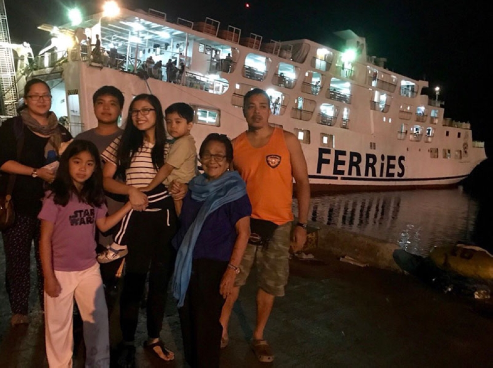 A picture of the barge at the CDO port, taken by my sister-in-law Gay Delos Reyes. My family with cousin, Zara, and great-granny, Gloria. (Hannah Victoria Wabe)