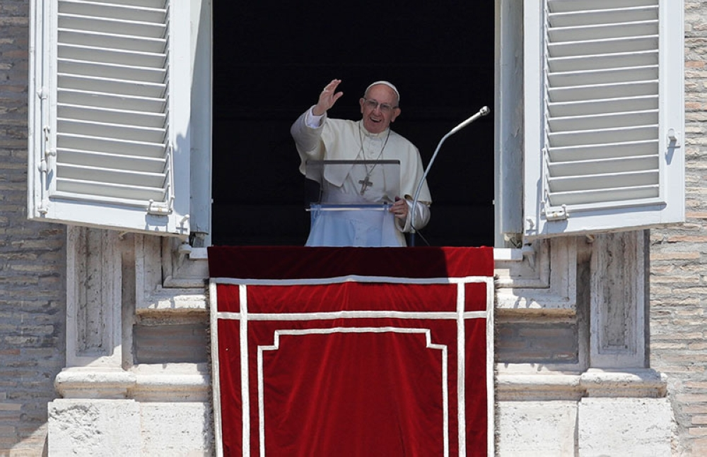 VATICAN. Pope Francis blesses the crowd as he recites the Angelus noon prayer from the window of his studio overlooking St. Peter's Square, at the Vatican, Sunday, July 8, 2018. (AP)