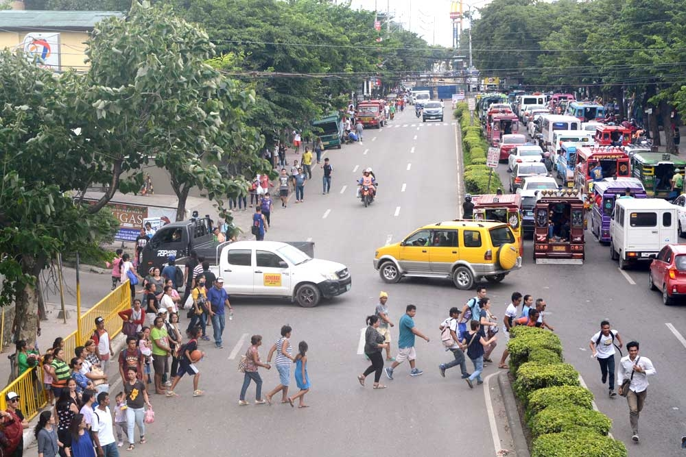 CEBU. Officials and enforcers tested a traffic scheme on N. Bacalso Ave. during the weekend, near the underpass construction site in Mambaling, Cebu City (background). (Arni Aclao/SunStar Cebu)