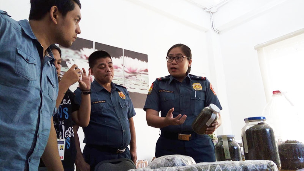 CEBU. Cebu City Police Station 2 Commander Ma. Theresa Macatangay shows to local reporters the marijuana seeds and leaves confiscated from Junemar Cabahug, the alleged