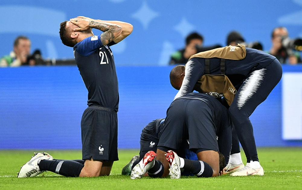 RUSSIA. France's Lucas Hernandez, left, celebrates after his team advanced to the final after the semifinal match between France and Belgium at the 2018 soccer World Cup in the St. Petersburg Stadium in St. Petersburg, Russia, Tuesday, July 10, 2018. (AP)