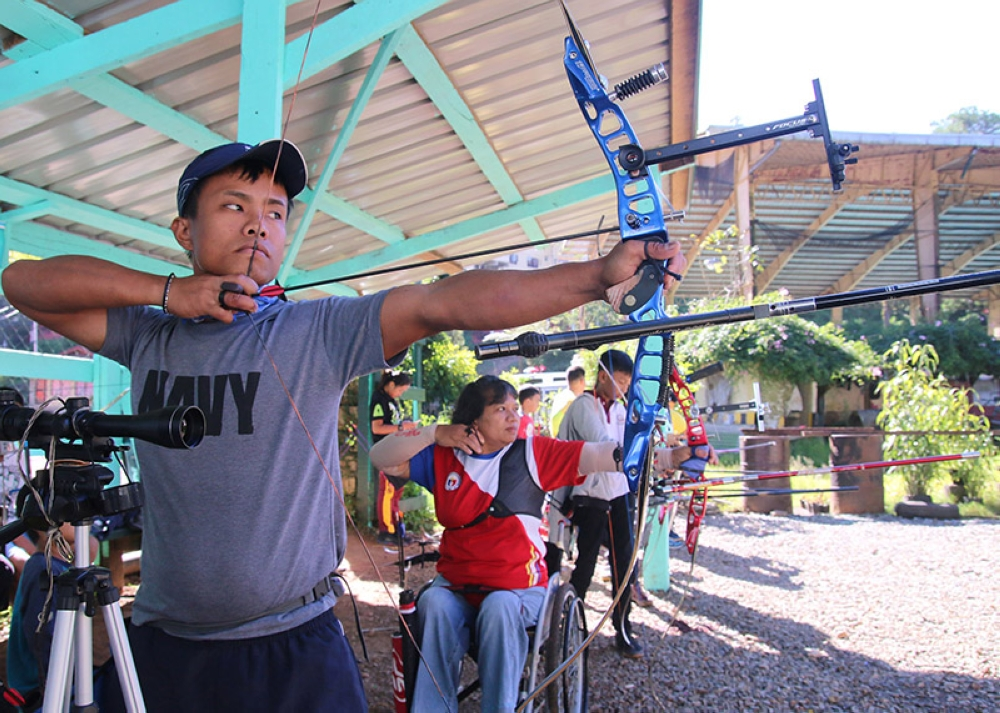 BAGUIO. Baguio para archer Giovanni Ola trains alongside fellow para archers at the Baguio Athletic Bowl archery range as he gears up for the 3rd Asian Para Games slated October 6 to 13 in Indonesia. (SSB photo)