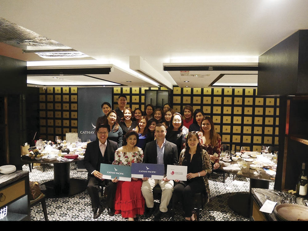 Fly and cruise crew. Cathay Pacific's Top Agents for 2017 at the awarding ceremony at Dragon Noodles Academy in Central, Hong Kong. Seated are (third from left), Cathay Pacific Philippines country manager Robin Bradshaw and top three agents (from left), Alan Carvajal of Travelways International, Aida Uy of Cebu Fortune Travel Inc., and Fairlie Uy of Royal Prince Travel Internatonal.
