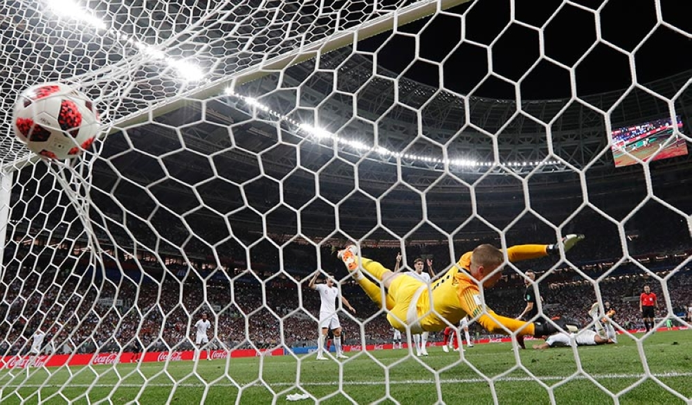 Croatia's Ivan Perisic scores his side's first goal past England goalkeeper Jordan Pickford during the semifinal match between Croatia and England at the 2018 soccer World Cup in the Luzhniki Stadium in Moscow, Russia, Wednesday, July 11, 2018. (AP)