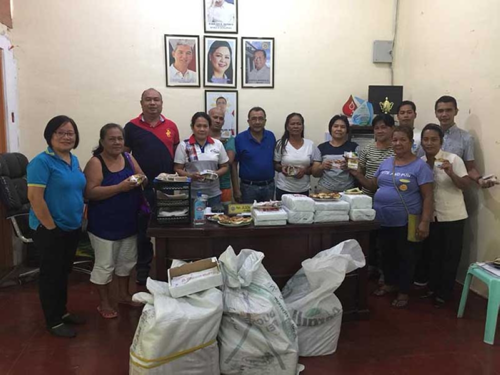 DTI-Negros Occidental Senior Trade and Industry Development Specialist Engiemar Tupas (third from left) and Mayor Jilson Tubillara (sixth from left) with the recipient-food processors during the distribution of packaging and labeling materials at San Enrique Municipal Hall on Tuesday. (Contributed Photo)