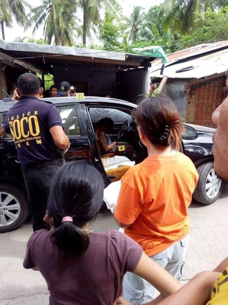 CEBU. The crime scene where Police Officer 1 Avita Sarzuelo was shot dead by unidentified assailants  past 5 a.m. Thursday, July 12, in Barangay Poblacion, Tabuelan, Cebu. (Photo courtesy of Tabuelan Police Station)