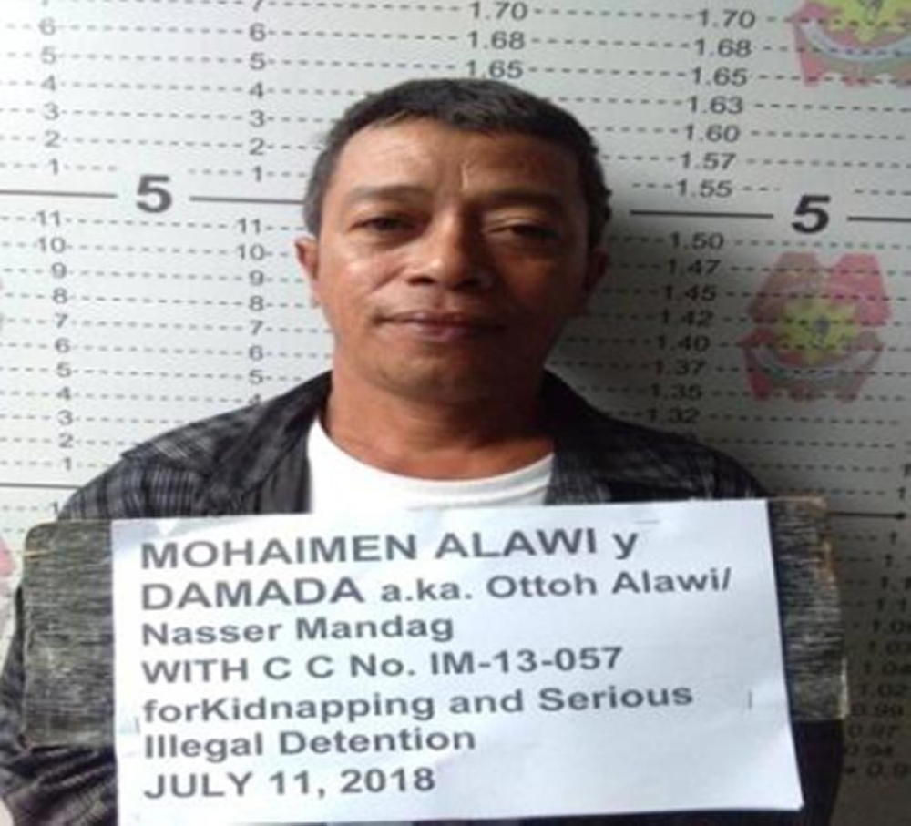 ZAMBOANGA. Police photo handouts show the mugshot of Mohaimen Alawi, who carries the aliases of Otto Alawi and Naser Mandag, 42, the number 9 most wanted person in Zamboanga Peninsula. (Bong Garcia)