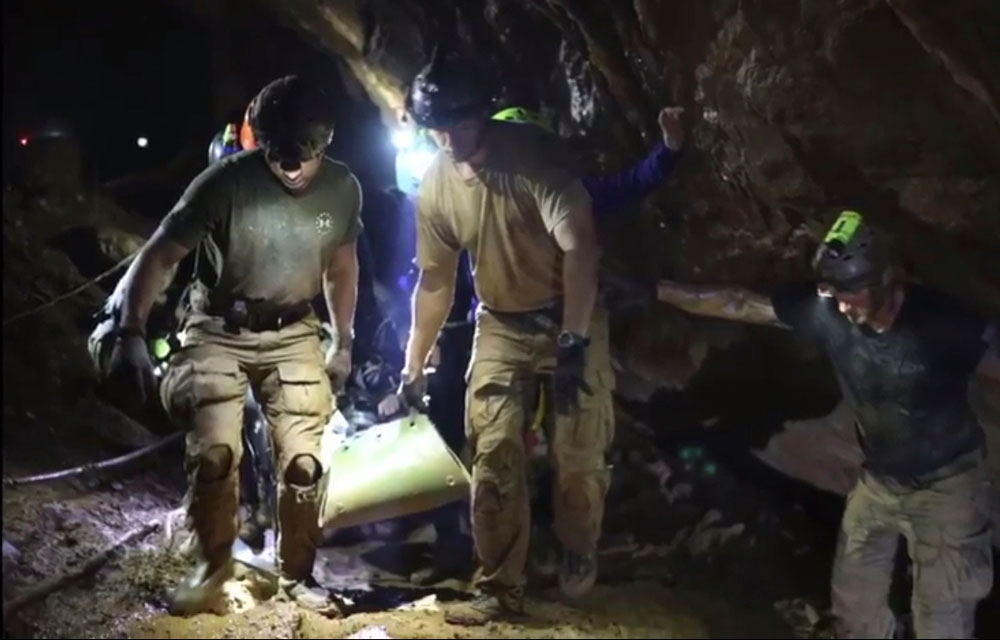 Rescue. This photo from the video released via the Thai NavySEAL Facebook Page shows rescuers holding an evacuated boy inside the Tham Luang Nang Non cave in Mae Sai, Chiang Rai province, in northern Thailand. (Thai NavySEAL Facebook Page via AP)