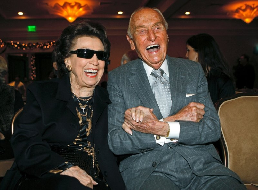 In this Dec. 12, 2007 file photo, Nancy Sinatra Sr. smiles with Paramount Pictures producer A.C. Lyles, as they attend the unveiling of a 10-ft. image of the Frank Sinatra commemorative postal stamp that will be issued by the United States Postal Service, during a ceremony commemorating Frank Sinatra's 92nd birthday, in Beverly Hills, Calif. Sinatra Sr., the childhood sweetheart of Frank Sinatra who became the first of his four wives and the mother of his three children, has died. She was 101. Her daughter, Nancy Sinatra Jr., tweeted that her mother died Friday, July 13, 2018. (AP)