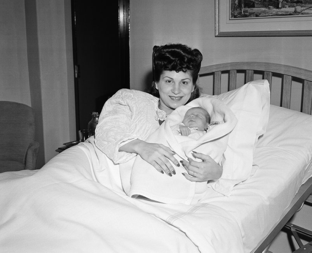 In this Jan. 10, 1944 file photo, Nancy Sinatra holds her newborn son, Frank, at Margaret Hague Maternity Hospital in Jersey City, N.J. Nancy Sinatra Sr., the childhood sweetheart of Frank Sinatra who became the first of his four wives and the mother of his three children, has died. She was 101. Her daughter, Nancy Sinatra Jr., tweeted that her mother died Friday, July 13, 2018. (AP)
