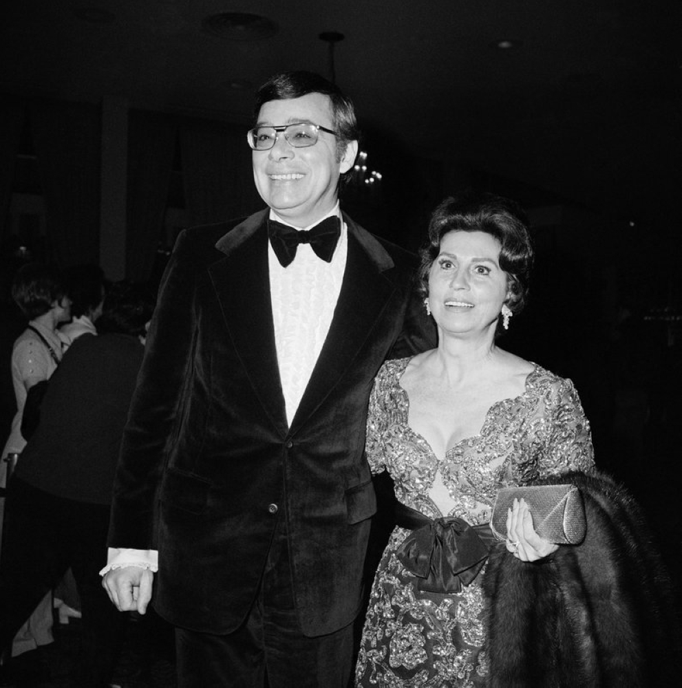 In this Feb. 5, 1971 file photo, producer Ross Hunter and Nancy Sinatra Sr., pose at the Golden Globe Awards in Hollywood, Los Angeles. Sinatra Sr., the childhood sweetheart of Frank Sinatra who became the first of his four wives and the mother of his three children, has died. She was 101. Her daughter, Nancy Sinatra Jr., tweeted that her mother died Friday, July 13, 2018. (AP)
