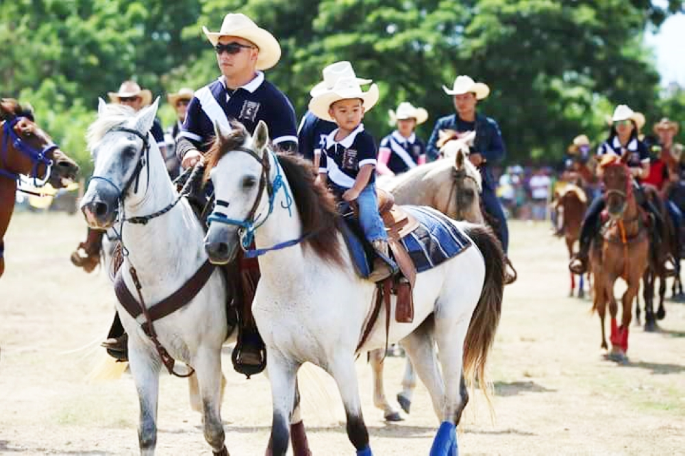 DAVAO. Kobi Tan and son Chase, the youngest rider of the event at 3 years old. (Photo from Davao Oriental Provincial Information Office)