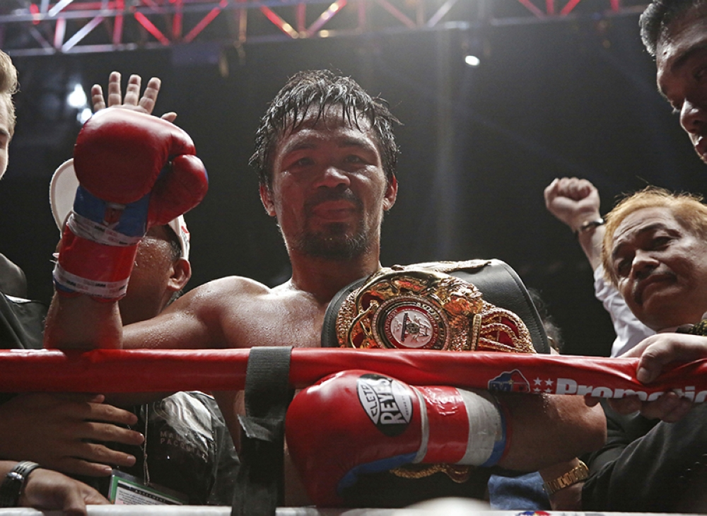 Manny Pacquiao of the Philippines poses after defeating Lucas Matthysse of Argentina during their WBA World welterweight title bout in Kuala Lumpur, Malaysia, Sunday, July 15, 2018. Pacquiao won the WBA welterweight world title after knocking out Matthysse on round seven. (AP)
