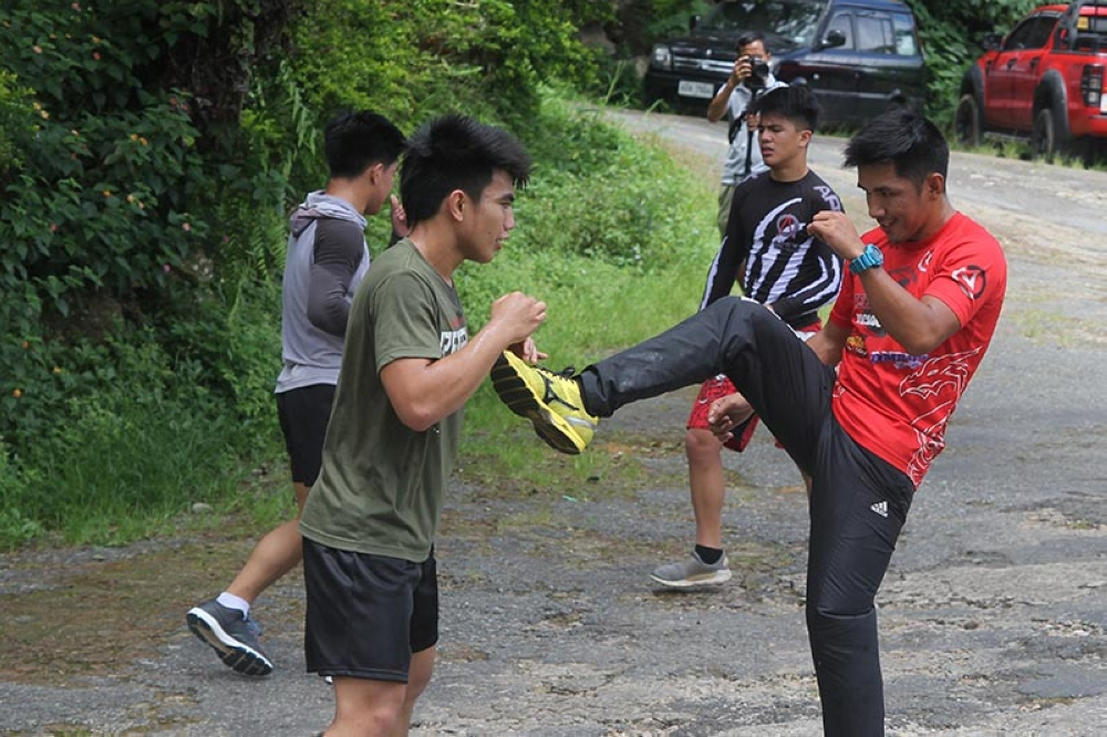 "BAGUIO. Joshua Pacio and ONE Championship flyweight champion Geje Eustaquio spars at the Lourdes Grotto as part of Joshua's training for the ""Reign of Kings"" on July 27 at the Mall of Asia Arena. (Roderick Osis)"