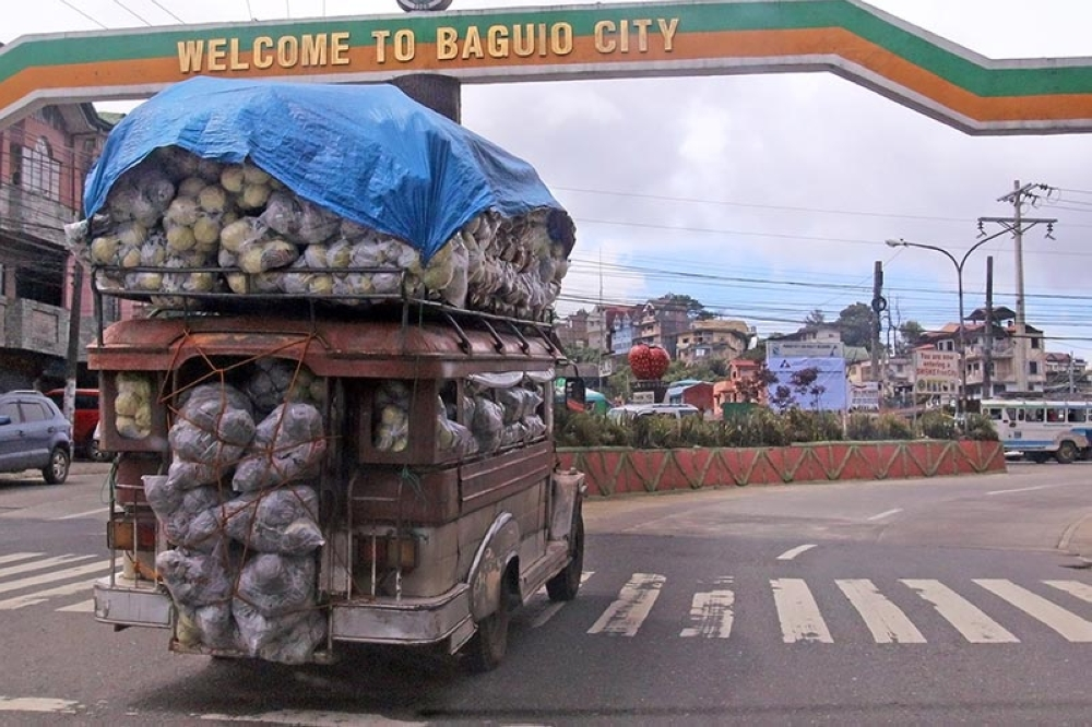 BAGUIO. A worn-out jeepney carries almost a ton of vegetables, more than its allowed capacity, not minding of the safety of other motorist and pedestrians. (SSB photo)