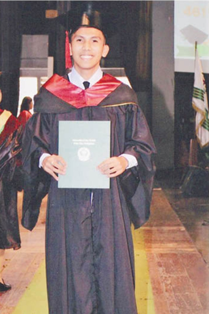 a diploma at last.With Dole's help, Nelvin Calamba Jr. graduates with a degree in civil engineering, which he finished as a scholar.   Contributed photo