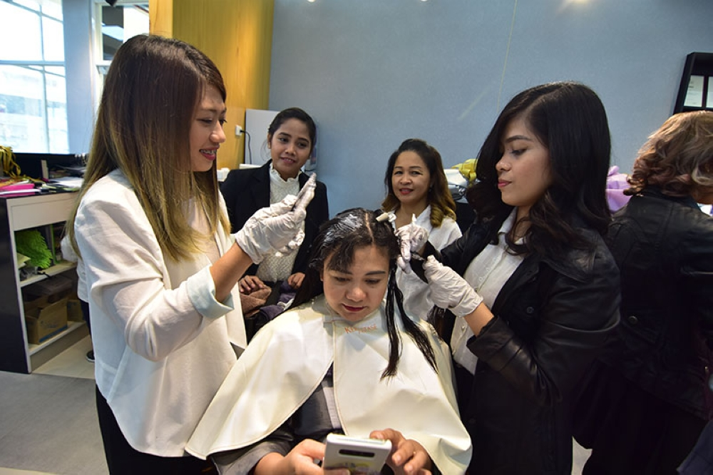 DAVAO. SVS Prime hairstylists give their client a hair treatment. (Contributed photo)