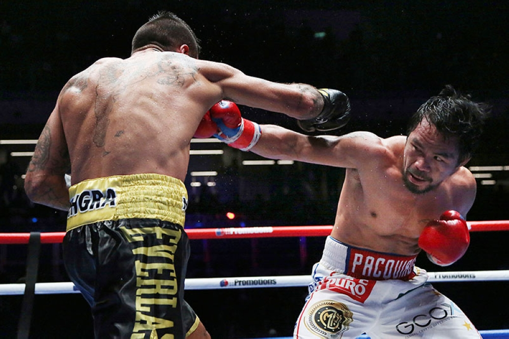 MALAYSIA. Manny Pacquiao of the Philippines (right) fights Lucas Matthysse of Argentina during their WBA World welterweight title bout in Kuala Lumpur, Malaysia, Sunday, July 15, 2018. (AP)