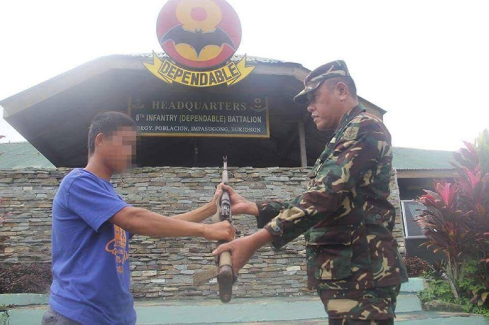 Two alleged members of the New People's Army (NPA), who are both in their 20s, surrendered to authorities over the weekend in Impasug-ong town, Bukidnon. (Photo courtesy of Fourid Diamond)