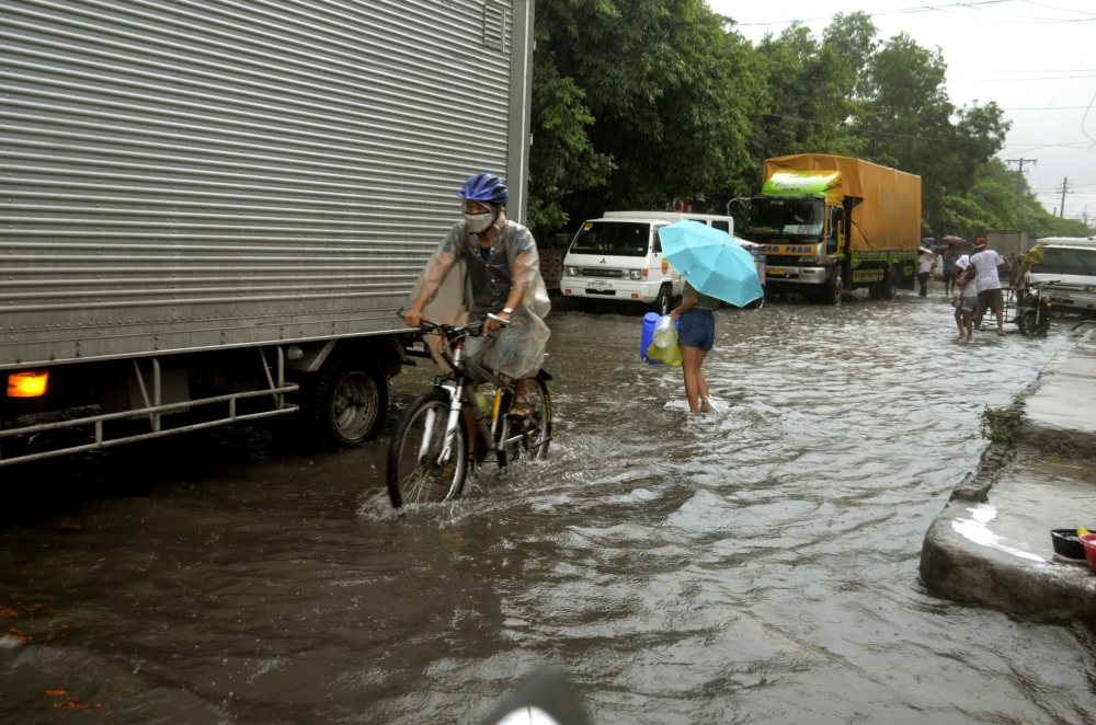 MANILA. Most of Metro Manila were flooded with ankle-deep water as monsoon rains continue to batter the region on July 17, 2018. (Alfonso Padilla/SunStar Philippines)