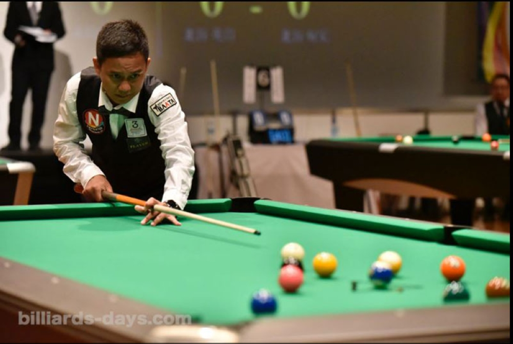ON CUE. Lee Vann Corteza of Davao City aims for a shot during a 31st Japan Open 2018 match at New Pier Hall in Tokyo, Japan recently. (Photo courtey of billiards-days.com)
