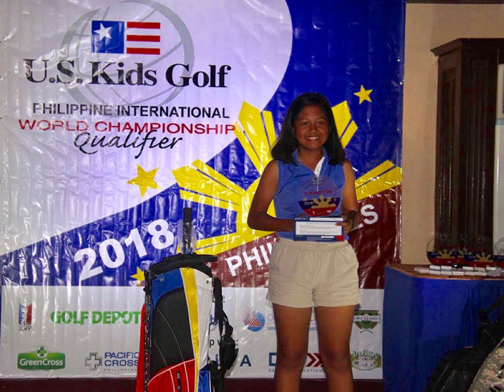 MANILA. Receiving her trophy at the US Kids Gold qualifier in Manila. (Contributed photo)