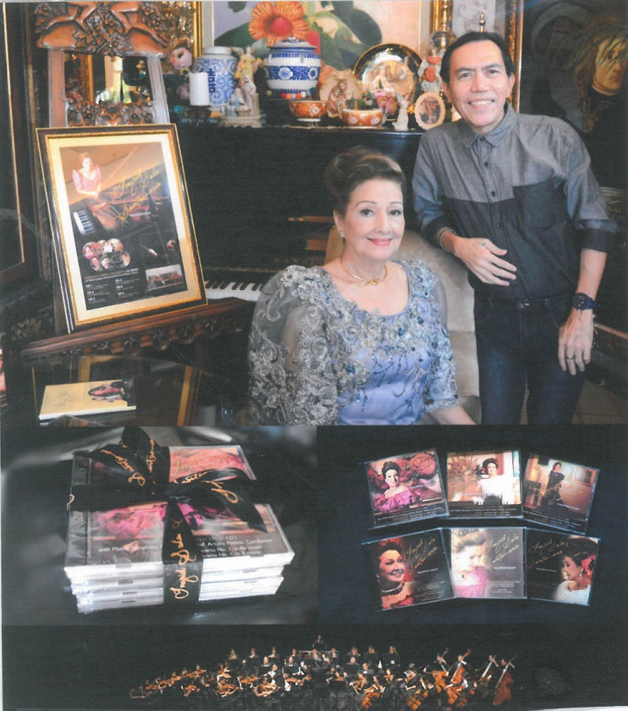 International concert pianist Ingrid Sala-Santamaria with her compact discs on YouTube, poses with Sam Costanilla.
